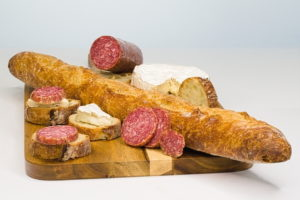 Charcuterie featuring salami and brie
