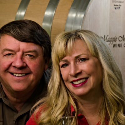 Mark and Maggie Malick in front of a barrel