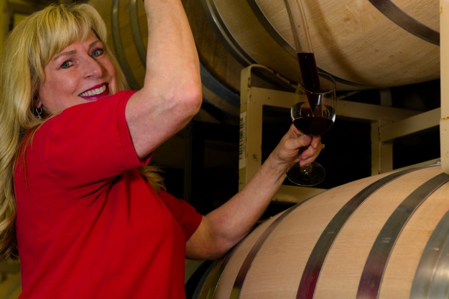 Maggie Malick with a wine thief