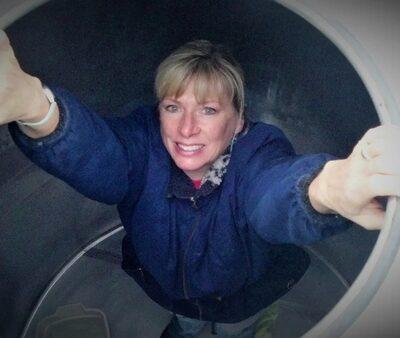 Maggie Malick inside steel fermenter