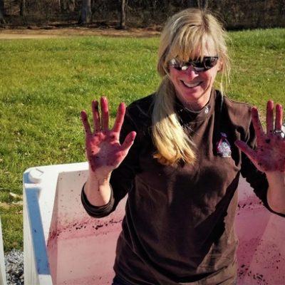 Maggie Malick crushing grapes