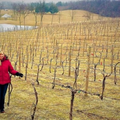 Maggie Malick in vineyard during winter